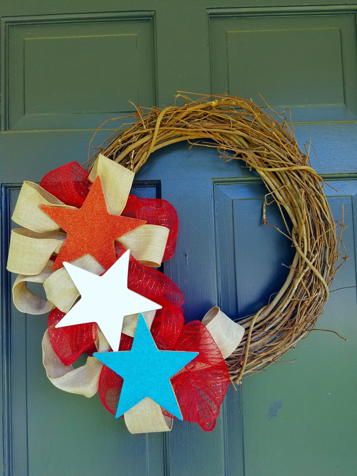 red, white, and blue stars on a grapevine wreath for the 4th of July